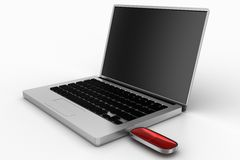 Red Pen drive Connected To Silver Laptop Stock Photos