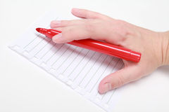 Red pen in the hand Stock Photo