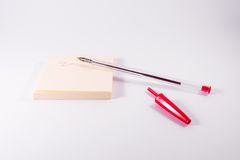 Red Pen Ink Writing Sticky Note Notepad Reminder Scribble White. Background stock photography