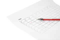 Red pen lay on sheet with table Stock Photo