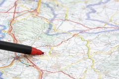 Red pen on a map Royalty Free Stock Photos