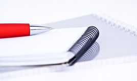 Red pen on a notebook, Royalty Free Stock Photos