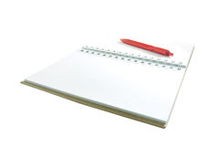 Red pen on notebook Royalty Free Stock Image