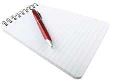 Red pen and notepad. Spiral bound notepad with red pen and copy space  on white background Stock Images