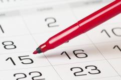 Red pen over calendar Stock Photography