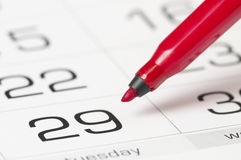 Red pen over calendar stock images