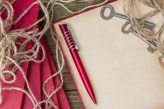 Red pen, red book Stock Photos