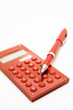 Red pen on the red calculator Royalty Free Stock Photography