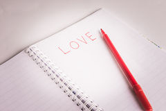 Red pen writing a love Stock Photography