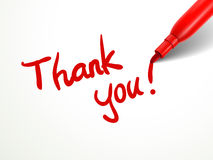 Red pen writing thank you over document. Closeup look of red pen writing thank you over document Royalty Free Stock Photography