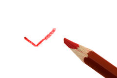 Red pencil. The red pencil which is drawn a sign Royalty Free Stock Images