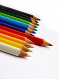Red Pencil. Standing out from assorted color pencils on a white background Royalty Free Stock Photography