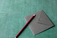 Red pencil and black envelope Stock Photo