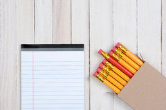 Red Pencil In Box with Note Pad Royalty Free Stock Image