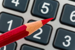Red pencil and calculator Stock Image