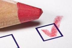 Red pencil - checked Royalty Free Stock Photography