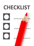 Red pencil on a checklist Stock Photos