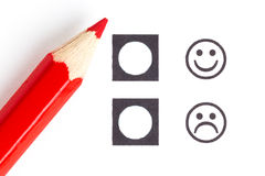 Red pencil choosing the right smiley Royalty Free Stock Photo