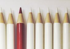The different from other. A red pencil are the different from other pencils that are white royalty free stock photo