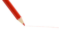 Red pencil  drawing a line Royalty Free Stock Image