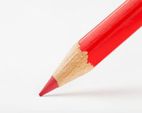 Red pencil draws or writing on white paper Royalty Free Stock Photos
