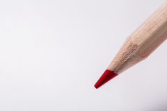 Red pencil draws or writing on white paper sheet Stock Photo