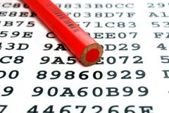 A red pencil and encrypted data sheet Stock Image