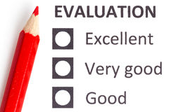 Red pencil on a evaluationform Stock Photos