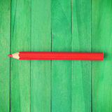 Red Pencil on Green Background Royalty Free Stock Image