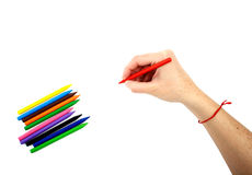 Red pencil in hand Stock Photography