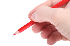 Red pencil in hand Stock Photos