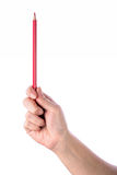 Red pencil in hand Stock Images