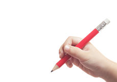 Red pencil in hand of child Stock Image