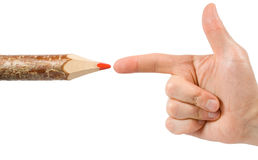 Red pencil and a hand with index finger Royalty Free Stock Photography