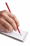 Red pencil in hand Royalty Free Stock Images
