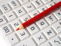 Red pencil. A red pencil is on the keypad of a calculator Stock Images