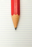 Red Pencil and lined paper Stock Images