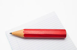 Red Pencil and lined paper Royalty Free Stock Photo