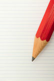Red Pencil and lined paper Royalty Free Stock Photos