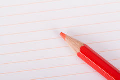 Red Pencil on Notebook Royalty Free Stock Images