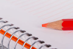 Red Pencil on Notebook Stock Photos