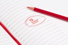 Red pencil and Notebook Stock Photography