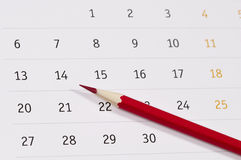 Red pencil over calendar Royalty Free Stock Photography