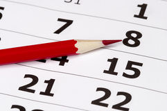 Red pencil over calendar. Red pencil over slightly defocused calendar background Stock Photography