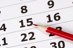 Red pencil over calendar Royalty Free Stock Photo