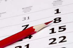 Red pencil over calendar Royalty Free Stock Image