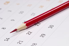 Red pencil over calendar Stock Photos