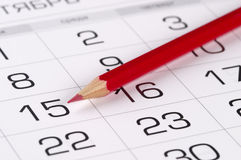 Red pencil over calendar Stock Images