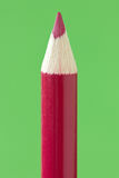 Red  pencil  over a green background Royalty Free Stock Photography