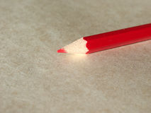 Red pencil over paper Stock Image
